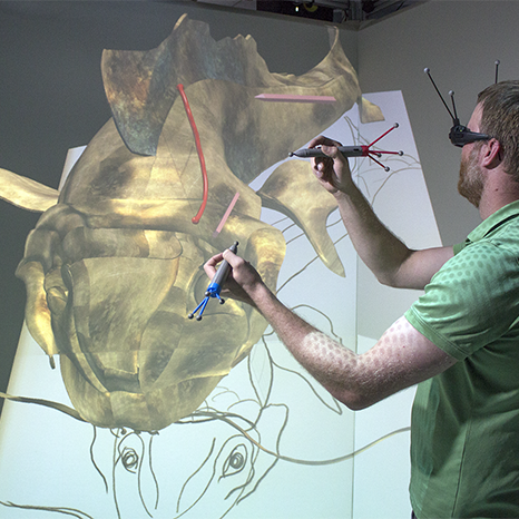 Artist creates a 3D model using a spatial interface